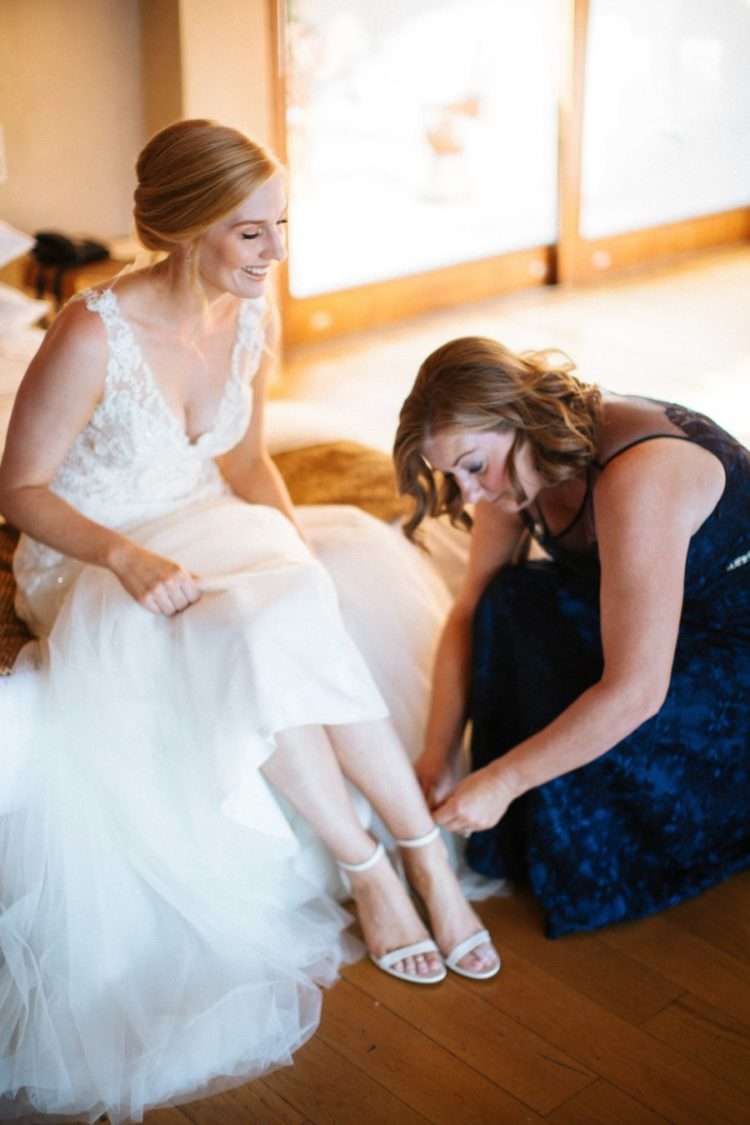 She was rocking neutral ankle strap shoes and here's her mom helping her to put them on