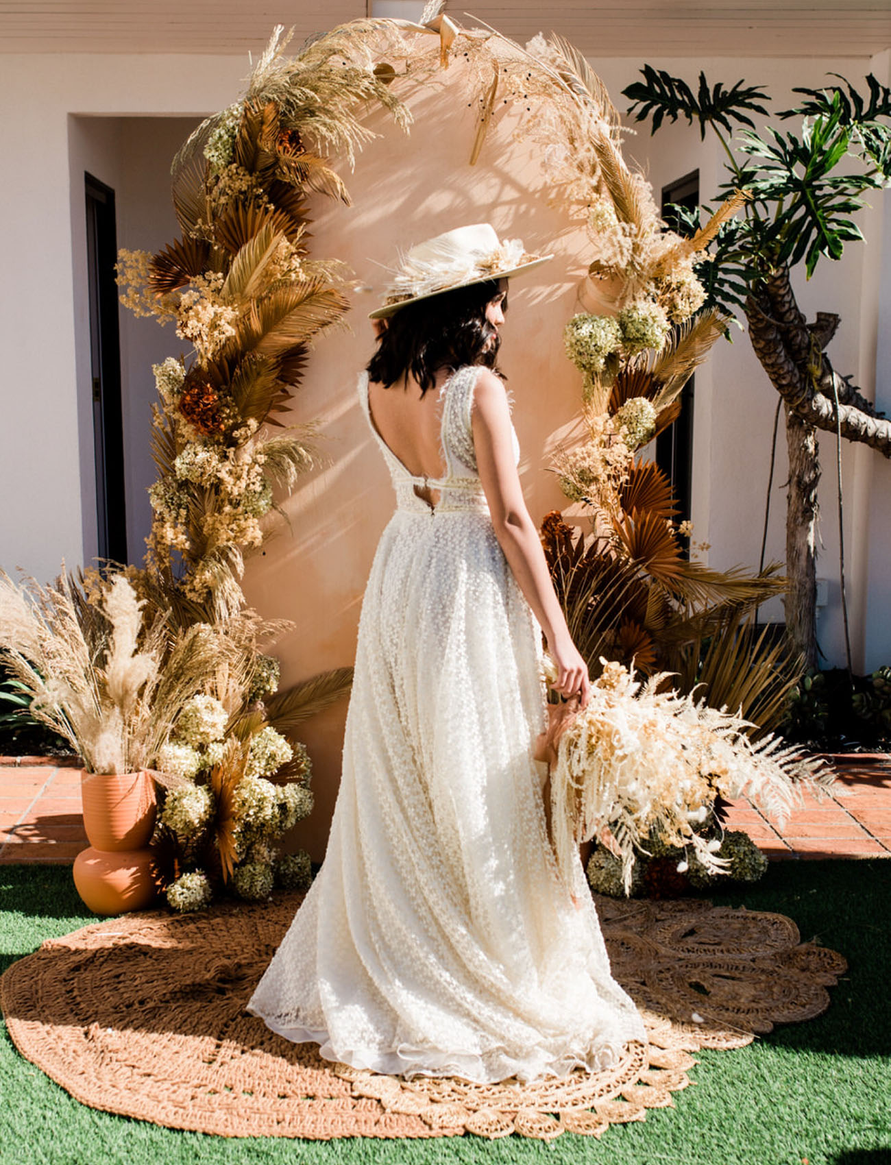 The bride was wearing a textural A line wedding dress with a plunging neckline and a cutout back