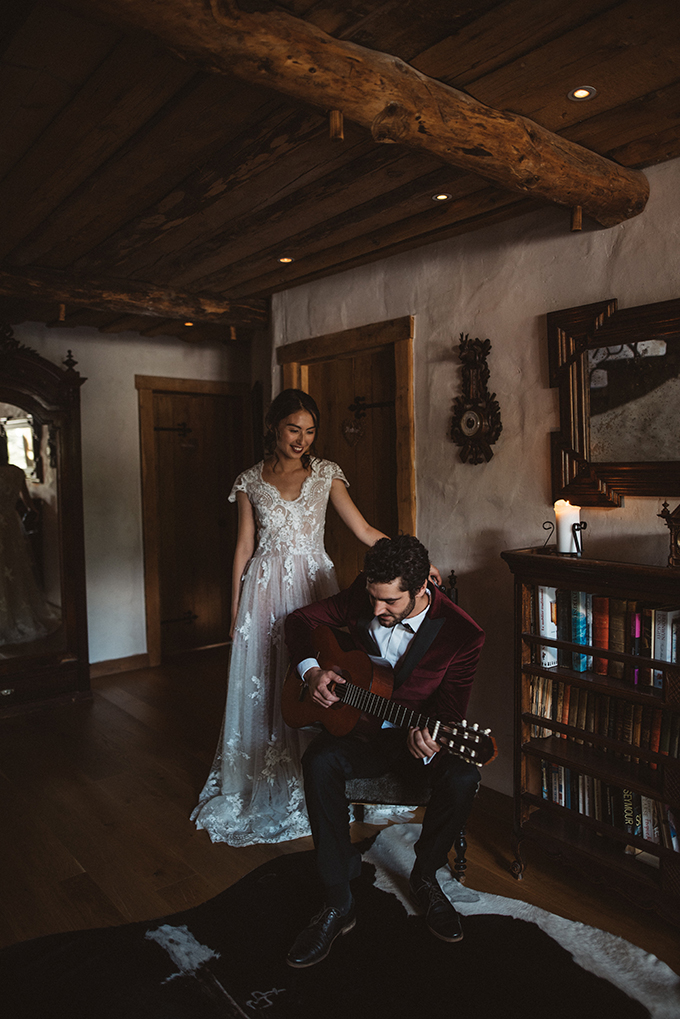 The bride was wearing a very romantic lace wedding gown with cap sleeves and a vintage feel, the groom was wearing a burgundy velvet tux