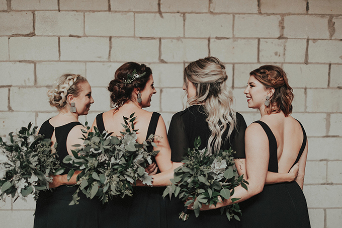The bridesmaids were wearing mismatching black maxi dresses