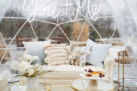 03 The wedding shoot took place in an igloo tent decorated with neutral florals and pampas grass plus animal skins