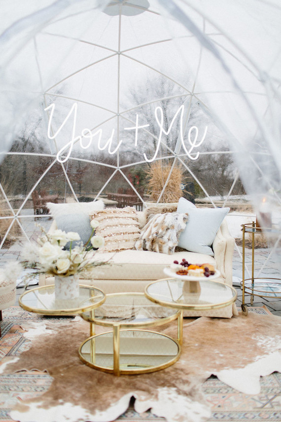 The wedding shoot took place in an igloo tent decorated with neutral florals and pampas grass plus animal skins