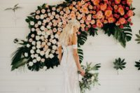 03 a lush ombre floral and tropical leaf wedding installation as a wedding backdrop for a wow effect