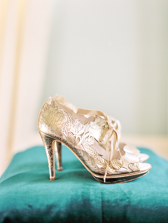 The bride was rockign stunning gold wedding shoes with roses on them and cutouts