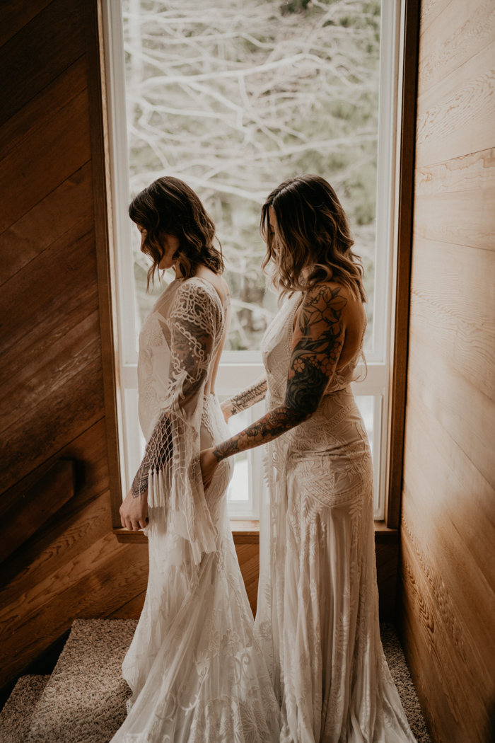 The girls were wearing gorgeous boho lace wedding dresses with tassels, fringe and bell sleeves