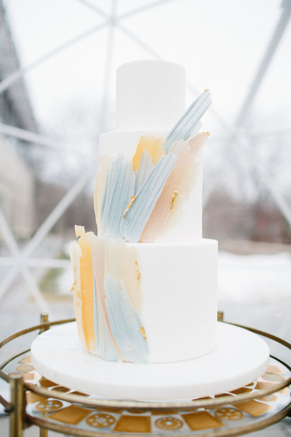 The wedding cake was decorated with pastel chocolate shards and gold leaf