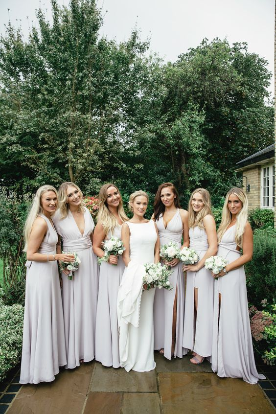 chic and sexy off-white bridesmaid maxi dresses with plunging necklines, ties and knots and front slits