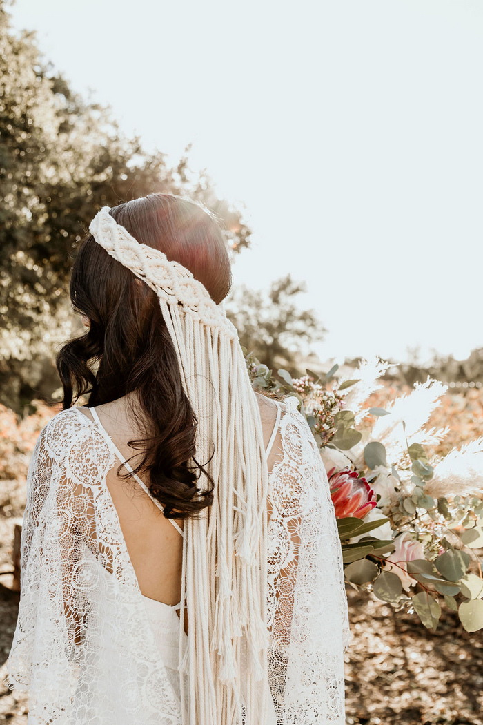 Her bridal headpiece was a macrame one, with long fringe