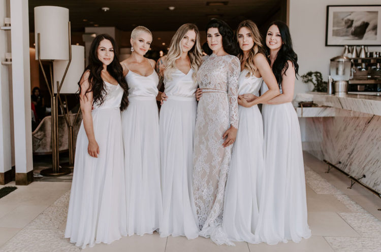 The bridal party was rocking all-white, with silk tops and tulle maxi skirts