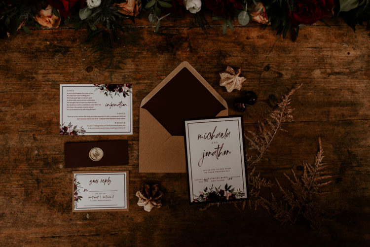 The wedding stationary was moody and was done in classic fall colors