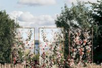 05 a modern bright floral wedding installation with three sheer walls and soem greenery is a gorgeous wedding backdrop