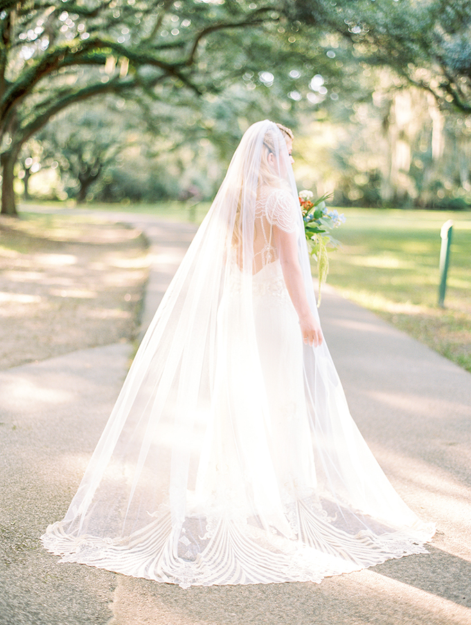 The bride was rockign a cathedral veil with gold touches
