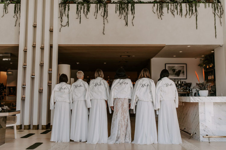 The girls covered up with white leather jackets that were calligraphed with names