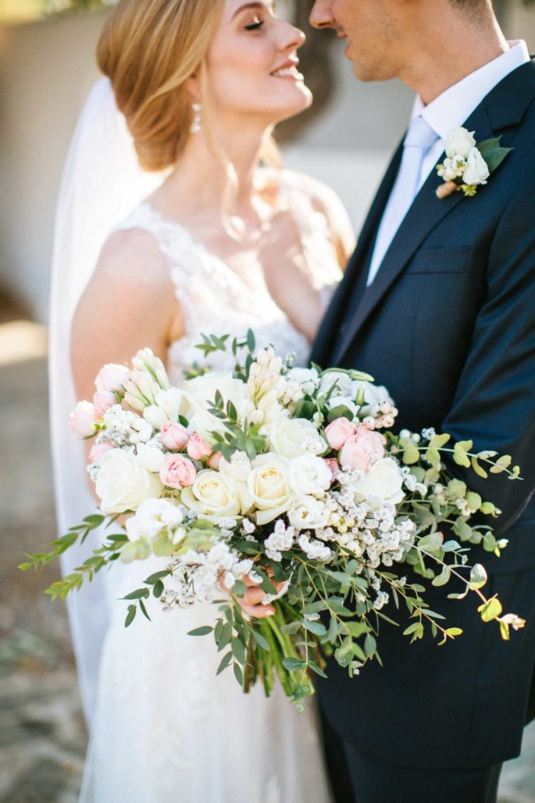 The wedding bouquet was blush and neutral, with much greenery and texture