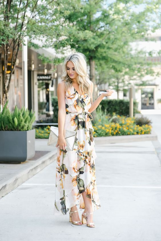 a creamy floral print wrap maxi dress is perfect for a summer wedding guest look with a V-neckline, metallic shoes and a metallic envelope clutch