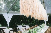 06 a floating pampas grass wedding installation over your reception tables will make them super trendy