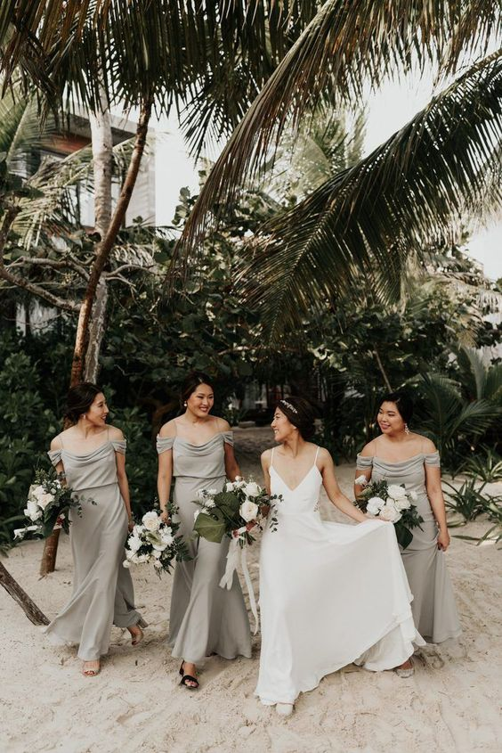 elegant grey cold shoulder maxi bridesmaid dresses with updos and statement earrings