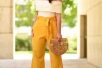 06 high waisted yellow pants, a creamy off the shoulder top, a straw bag and statement earrings