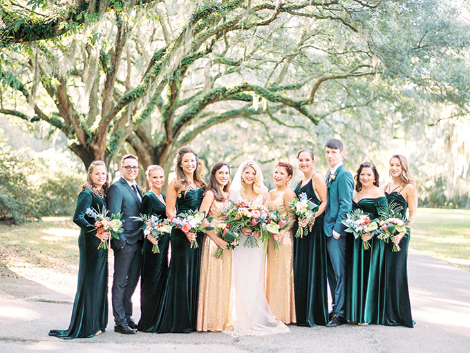 The bridesmaids were wearing green velvet gowns and the maids of honor were rocking gold