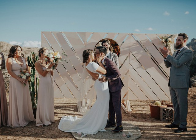 The wedding backdrop was a blush chevron one and it was DIYed by the bride