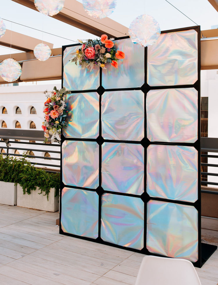 The wedding backdrop was iridescent, which is very unusual, modern and bold