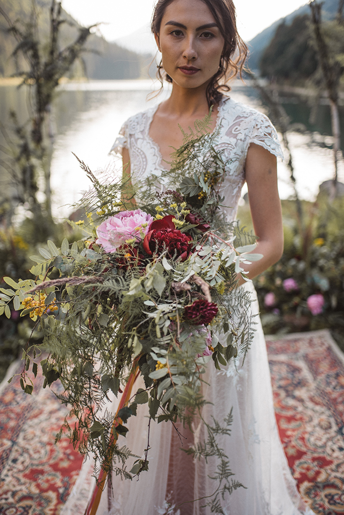 The wedding bouquet was a lush greenery and bright bloom one, with bright berries