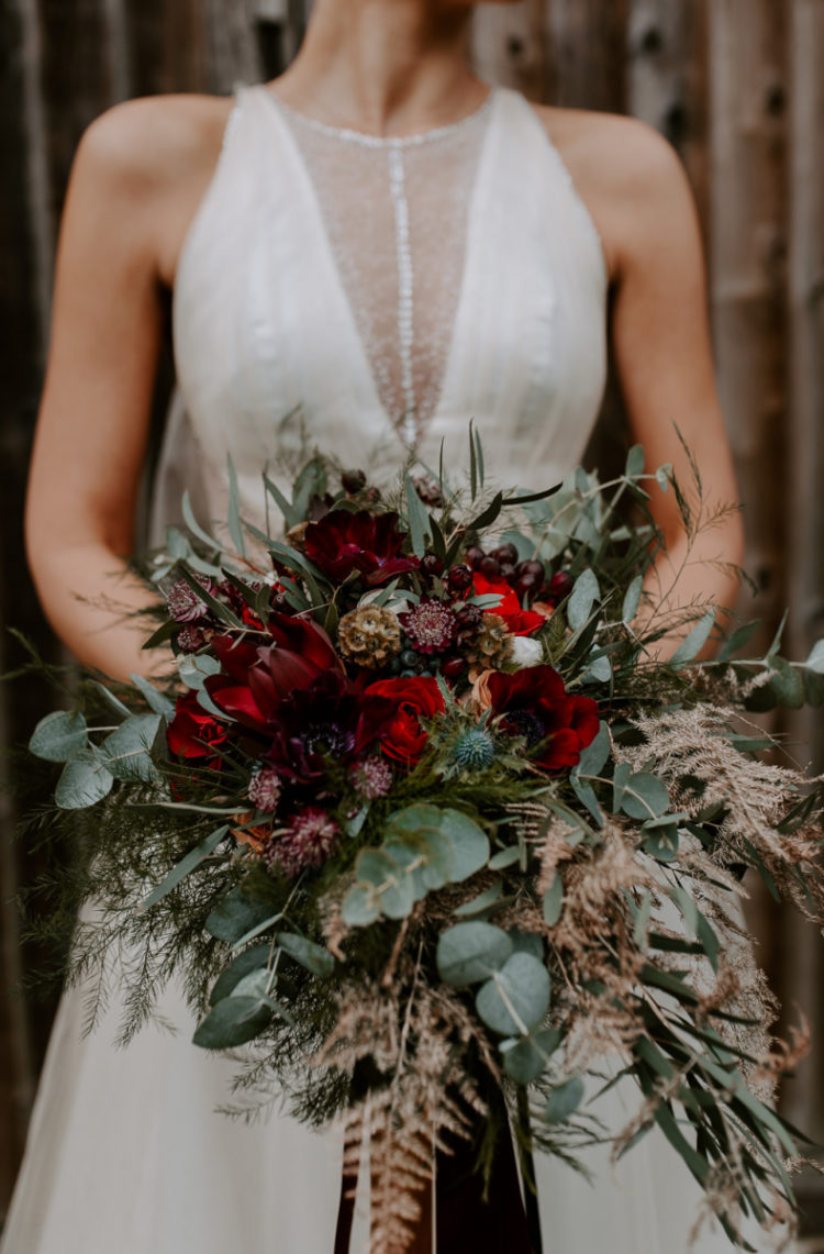 The wedding bouquet was lush and textural, with eucalyptus, thistles and lots of blooms and berries