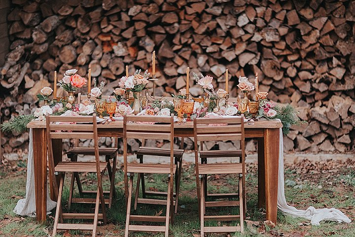The wedding table setting was done in earthy tones, it featured an uncovered wooden table and wooden chairs
