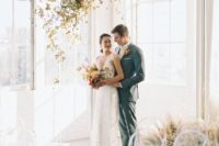 07 a gorgeous gilded foliage wedding installation is a great wedding ceremony backdrop