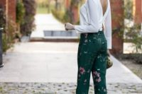 07 dark green floral pants, a white blouse with a cutout back, a back necklace, a metallic clutch and fuchsia shoes