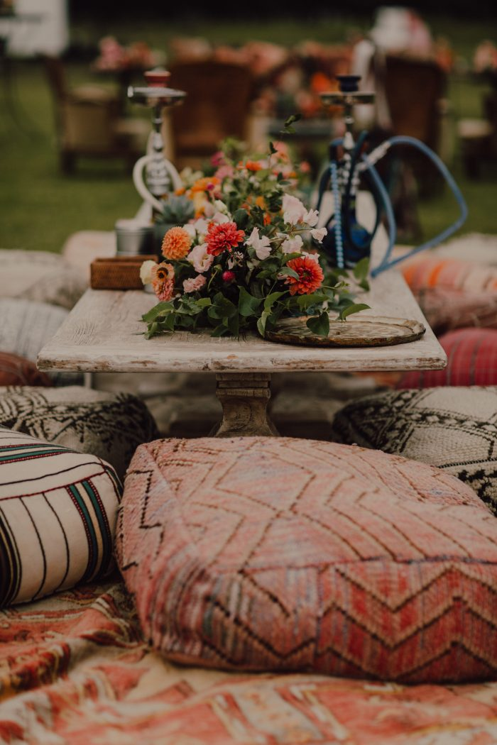 some poufs and ottomans will be a nice fit for a boho wedding reception and you may brign them from your home