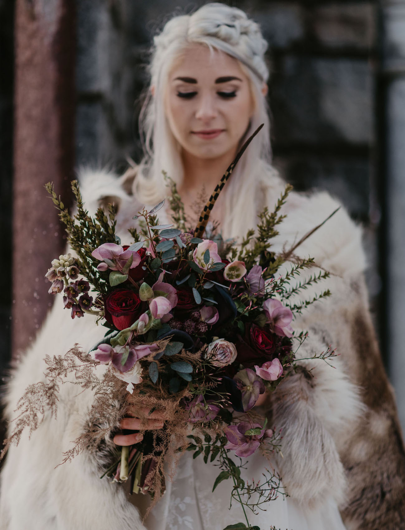 The bridal bouquet was done in moody shades and with much texture