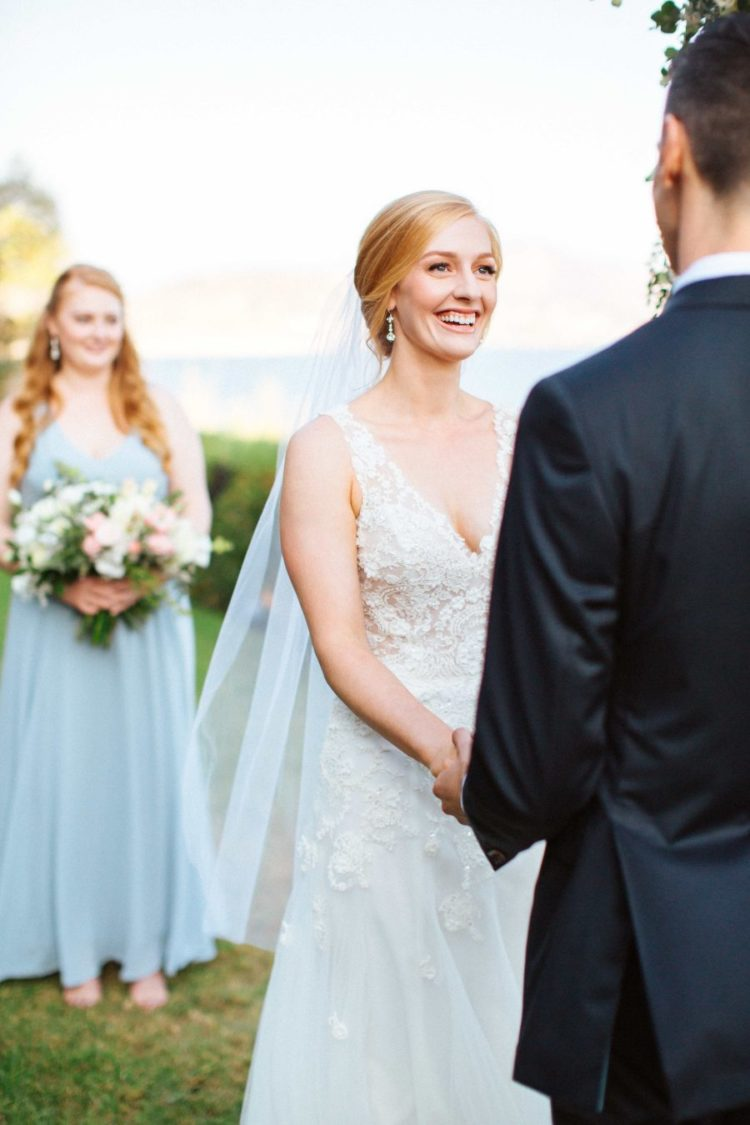 The bridesmaids were wearing light blue maxi dresses and statement earrings
