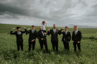08 The groomsmen were wearing black suits and the groom opted for a moody floral tie