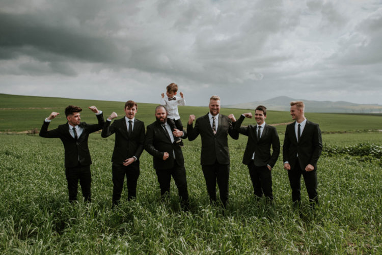The groomsmen were wearing black suits and the groom opted for a moody floral tie