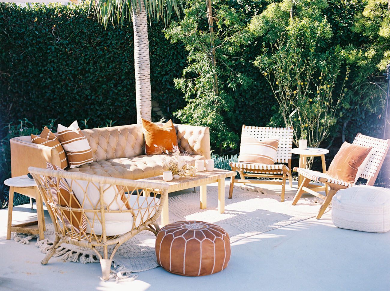 The lounge was a boho chic one, in the colors of the shoot   orange, rust, neutrals and featured rattan and leather furniture