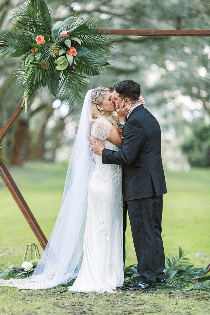 The wedding arch was created by the couple and decorated with bright florals