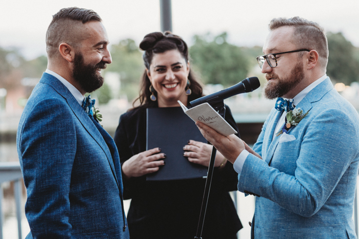The wedding ceremony took place outside, by the river, and the officiant was the couple's friend