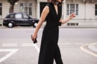 08 black cropped pants, a black sleeveless waistcoat with a sash, catchy black heels and a tiny clutch