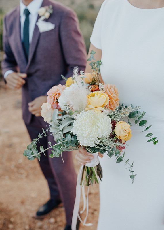 The bridal bouquet was bright, with yellow, orange and blush blooms