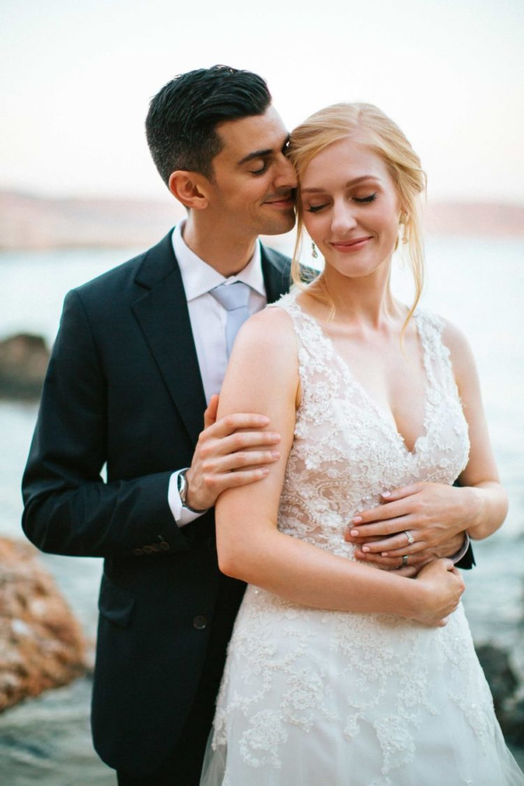 The couple went for some tender and romantic wedding portraits on the seashore