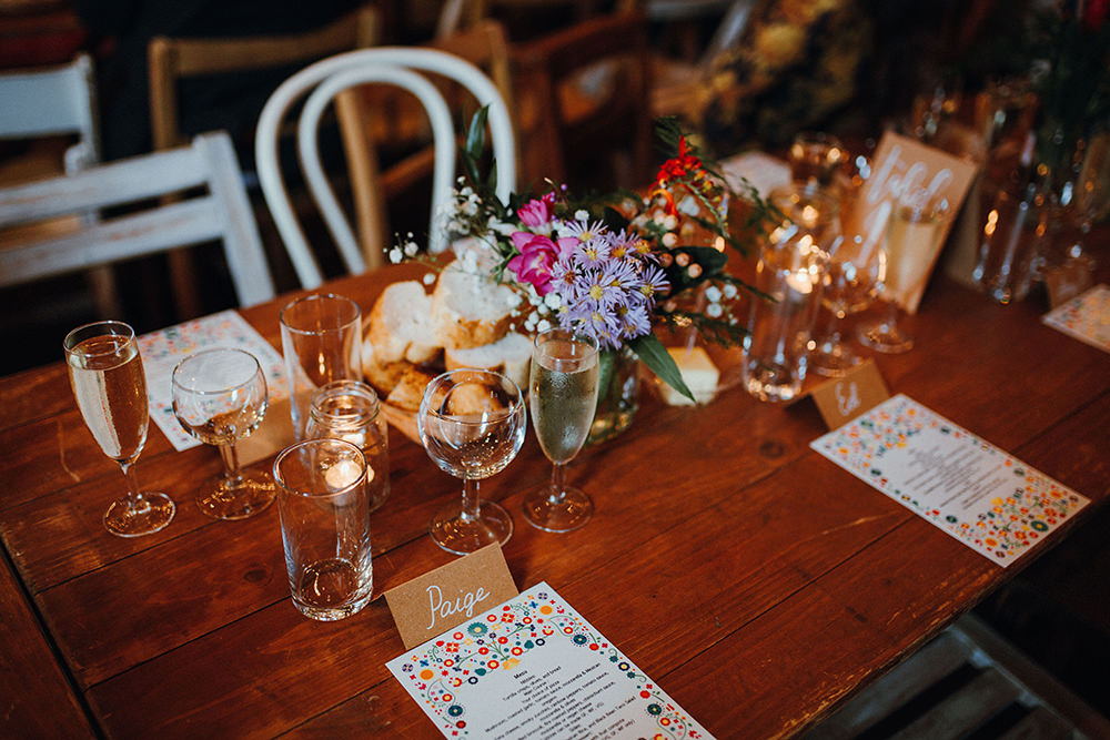 wedding tables with bright bloom centerpieces