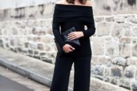 09 black culottes, a black strapless top with long sleeves, a black clutch and black mules