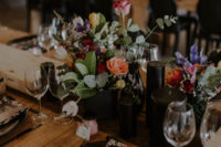 10 Black candles, black chargers, vases and airy table runners create a chic ambience