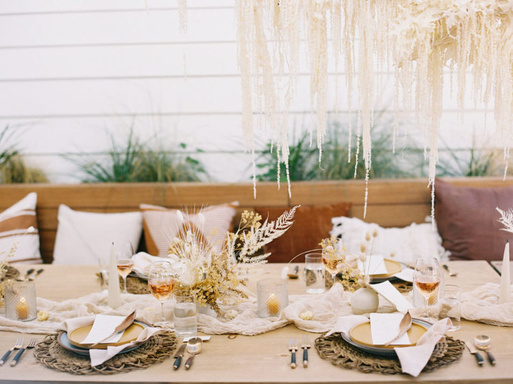 Candles and an airy table runner added chic to the reception table