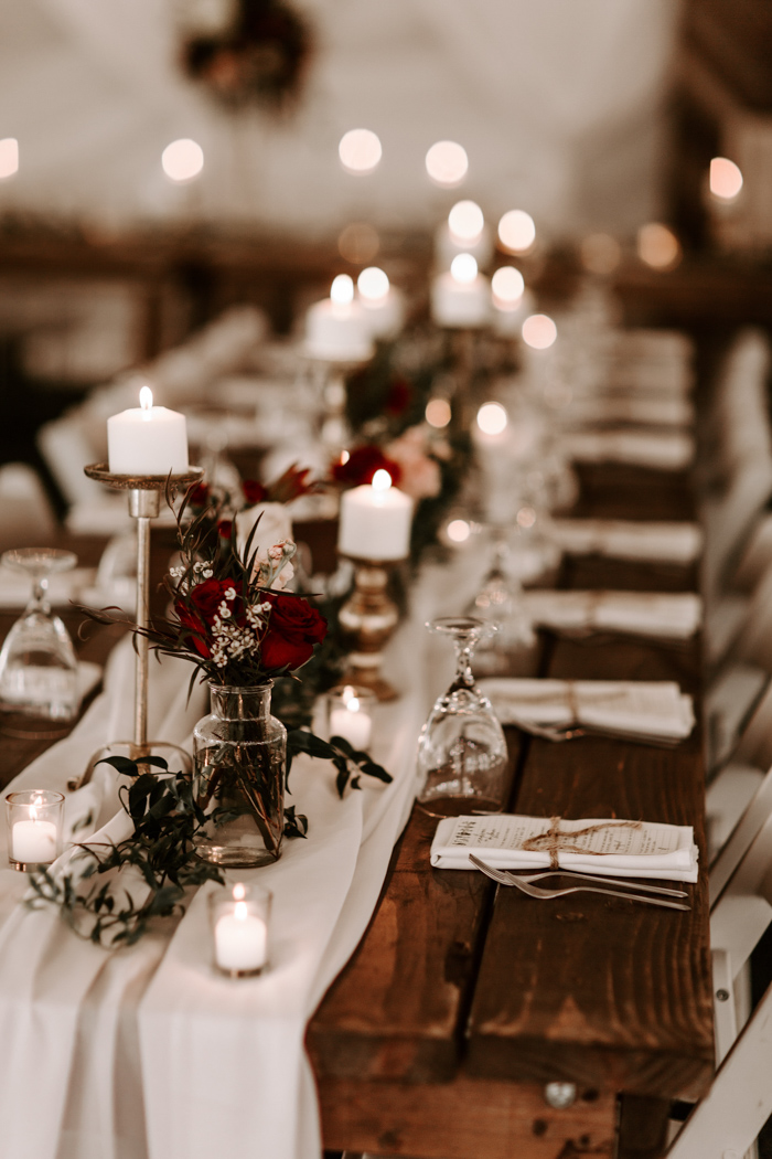 Other tables were uncovered, with airy table runners, greenery, burgundy centerpieces and candles