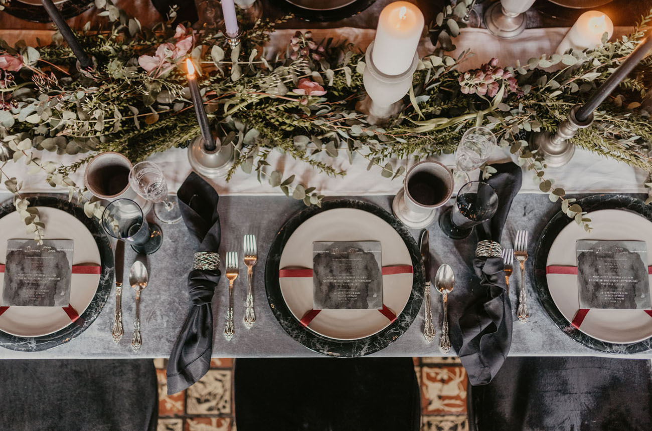 The wedding tablescape was done with marble chargers, black and white candles, black napkins and elegant cutlery