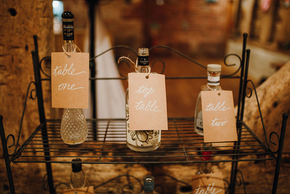 To mark the tables the couple used bottles with tags