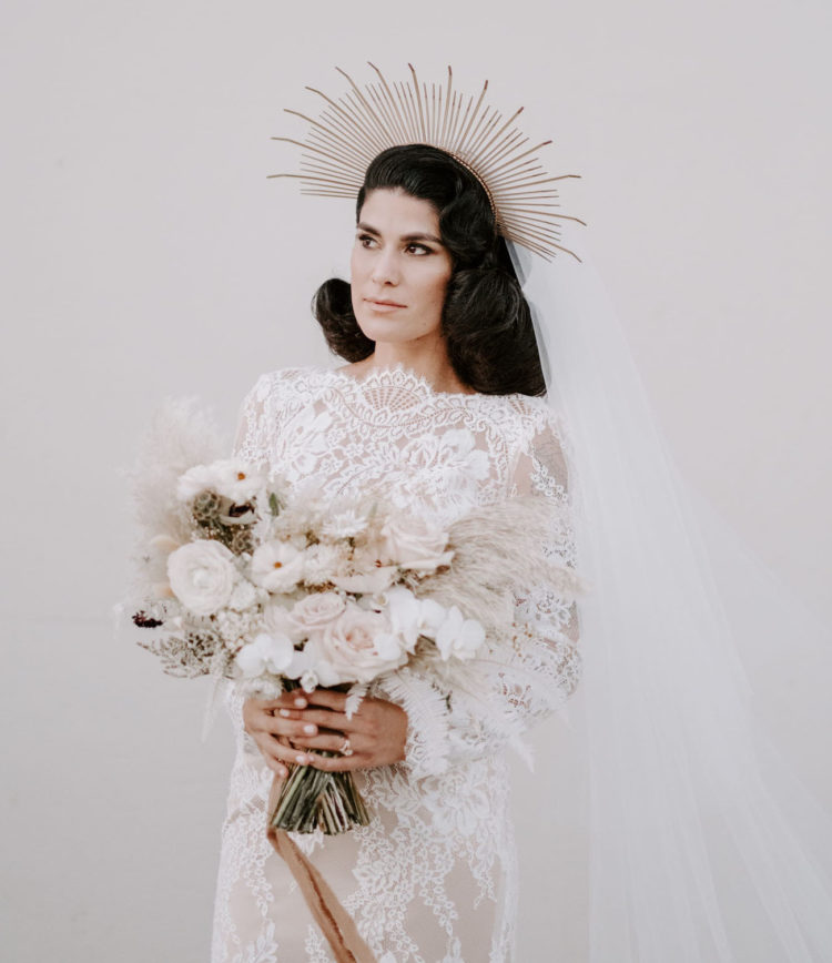 The bridal bouquet was all-white, with pampas grass and a neutral ribbon