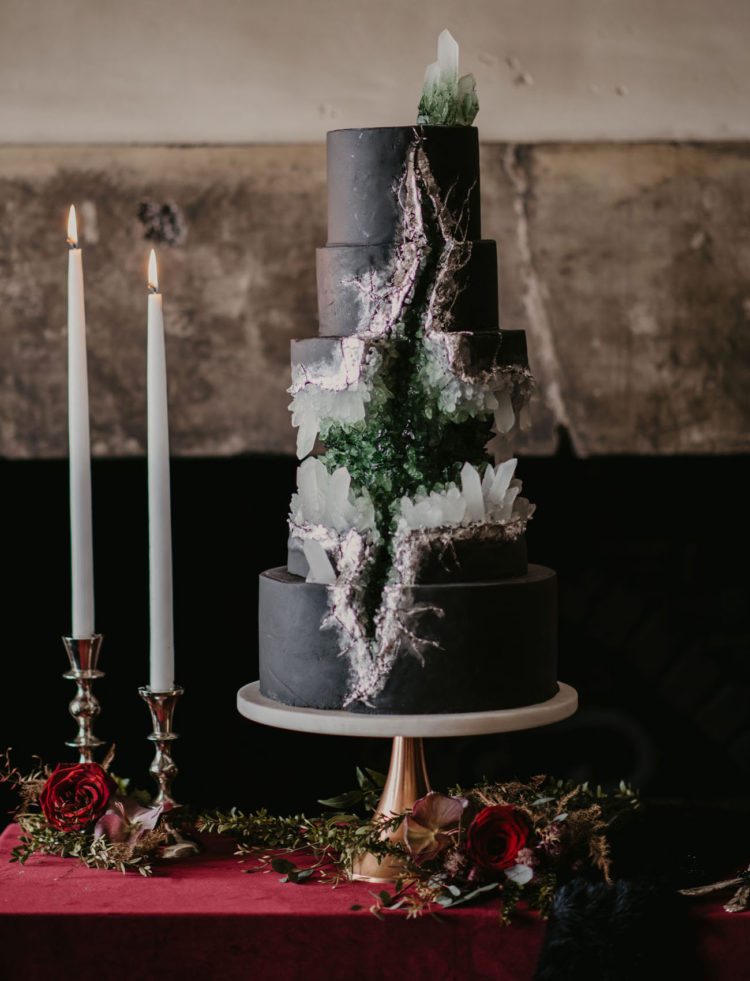 The wedding cake was a black one with many geodes in neutrals and green
